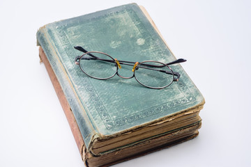 Bifocal reading glasses on vintage book