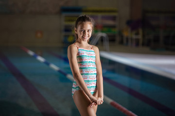 Smiling young girl in swimming pool