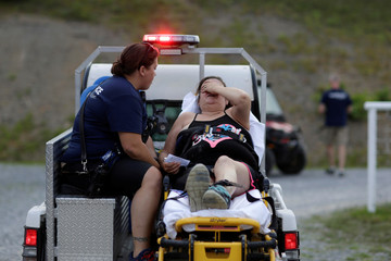 A woman is taken for treatment after she collapsed at the Remote Area Medical Clinic in Wise