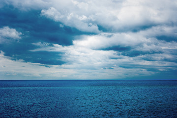 Dark clouds over the water of the sea. Summer.