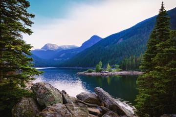 Serene Mountain Lake. Rocky Mountains Scenic Background.