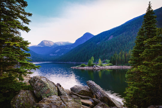 Serene Mountain Lake. Rocky Mountains Scenic Background. Beautiful Copy Space.