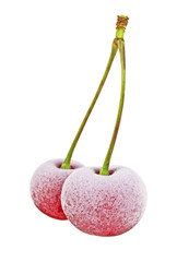 Two frozen cherries on a white background