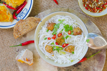 Banh Canh - one of most popular soup noodle in the seaside area with rice noodle, grilled fish, green onion and fish sauce...