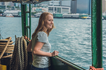 Young woman on a ferry in Hong Kong