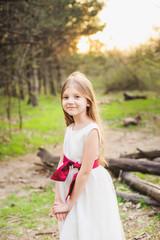 Beautiful little girls in dresses walking in the park