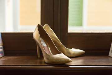 Gold Wedding Shoes on Window Sill