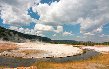 Iron Spring Creek and Cliff Geyser in Black Sand Geyser Basin in Yellowstone National Park in Wyoming US of A