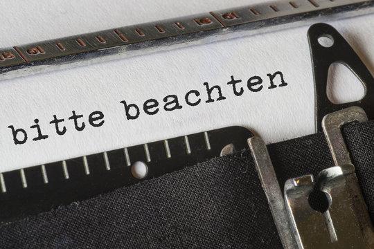 bitte beachten, Text Schreibmaschine