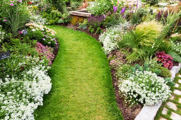 Foto auf Acrylglas Garten massif en fleur