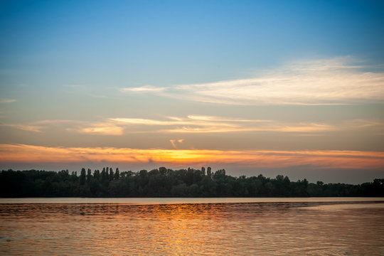 beautiful majestic sunset on the background of the river bank with no people in Dnipro Kiev Ukraine