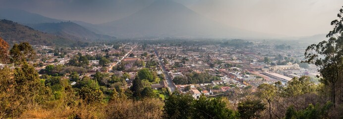 Aerial view of Antigua, Guatemala. Volcano Agua in the background.