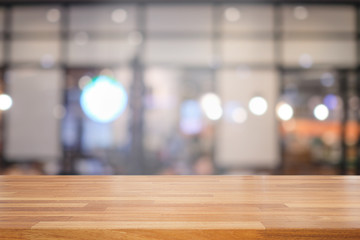 Empty wooden table and blurred  modern kitchen cafe background