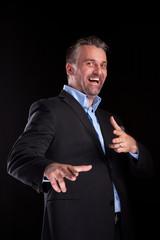 Happy adult confident businessman in studio photo on black background