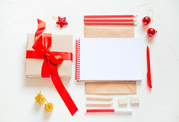 Flat lay of Christmas giftbox and toys, supplies. A letter to Santa Claus. Holiday concept.