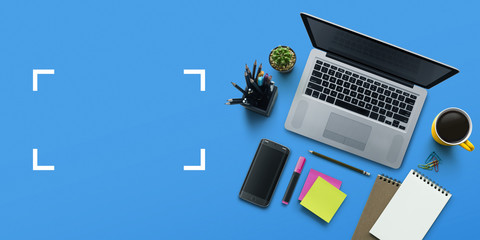 Office workplace with laptop, notebook, office supplies and stationery on blue background. Solution, business planning, creative, design, learning, start up or working flat lay top view concept. Wall mural
