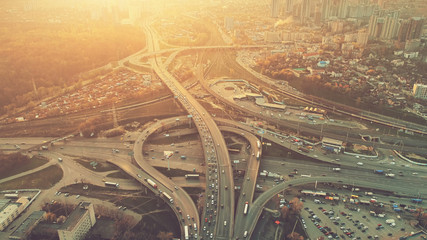 Aerial Drone Flight View of freeway busy city rush hour heavy traffic jam highway. Top view. Cityscape in sunset soft light. Instagram vintage filter toning. Kiev, capital of Ukraine Wall mural