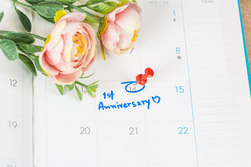 word anniversary celebration plan on calendar with flower