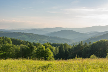 Beskidy mountains panorama, Poland landscape, green spring meadow,