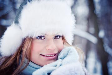 Beautiful girl in a winter snowy park