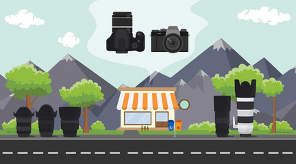 digital camera store on sidewalk with tree and mountain as background