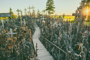 Hill of crosses (Kryziu kalnas), pilgrimage site in northern Lithuania, summer sunset time