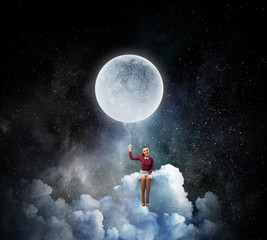 Woman sitting on cloud . Mixed media