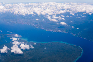 Indonesia tropical paradise crystal water turquoise aerial view from plane