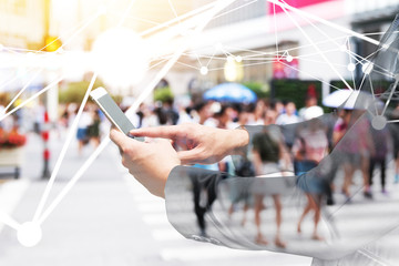 Fototapete - Digital transformation of internet of things technology disruption , big data ,online shopping concept. Neural networks connect atoms , business man using smart phone and blur city people cross road.