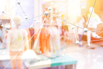 Smart retail , deep learning , neural networks technology and marketing concept. Artificial intelligence atoms connect with retail fashion shop store background. Warm tone with flare light effect.