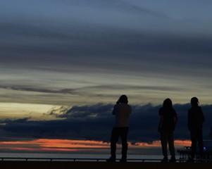 Silhouette figures sunset