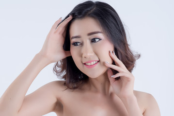 Beautiful Young Woman with Clean Fresh Skin touch own face , beauty and spa