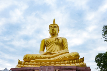 Golden Buddha images on sky clouds background.Golden Buddha statue in a Buddhist temple