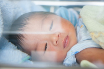 Newborn baby with glass double exploser