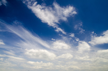 White clouds in deep blue summer sky, natural sky background