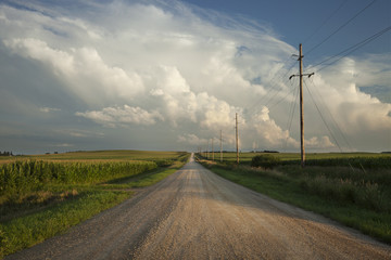 Rural road with dramatic clouds in southern Minnesota at sundown Wall mural
