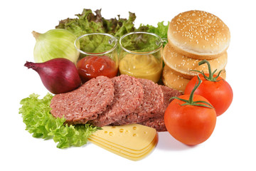 Hamburger, minced beef and the rest of the ingredients, on a white background