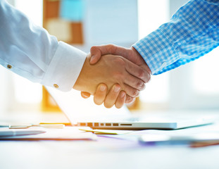 businessmen shaking hands in the office.