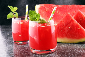 Tasty fresh appetizing watermelon drink smoothie. Watermelon drink in glasses with slices