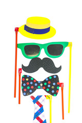 Top view image of funny beard, glasses, mustache, tie and bow on wooden background. Father's day concept