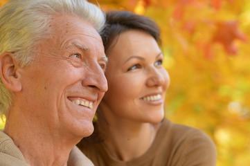 woman and senior man smiling