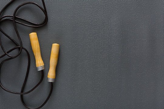 Top view of jump rope on black background