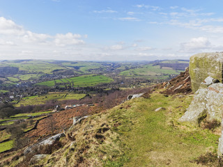 From high up in the Peak District, on a bright spring day, the fields, woodlands and towns of Derbyshire stretch to the horizon.