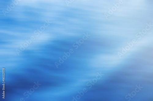 Wall mural Abstract lighting on water ripple in blurred background concept