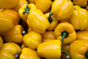 Fresh yellow peppers on the market