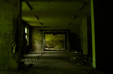 Large empty green room of the abandoned building with a peel wallpapers