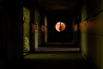 Scary shabby corridor of the abandoned building in Germany near Potsdam