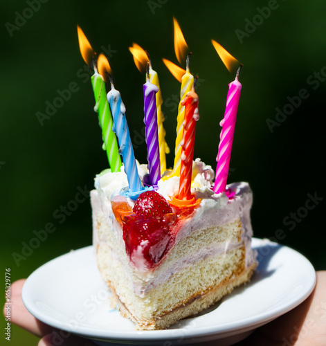 Girl Holding Beautiful Appetizing Birthday Cake With Many Candles On Green Nature Background