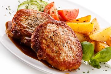 Grilled steaks, chips and vegetable salad