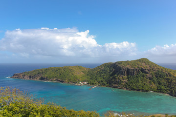 Green island and sea with cloud